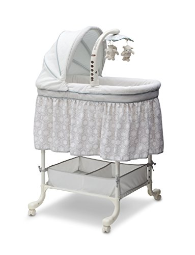 Simmons Kids Deluxe Gliding Bedside Bassinet - Portable Crib with Activity Mobile Arm Featuring Spinning Toys, Vibration, Calming Nightlight and Music, Seaside